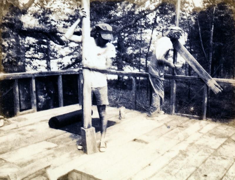 Doug building house ridge pole