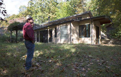 Douglas Stevenson outside one of many birthing centers on The Farm. -- Michelle Morrow | The Ledger